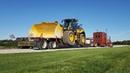 Везу новый огромный Джон Дир погрузчик. New John Deere wheel loader.