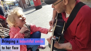 6 year old girl who is blind and autistic plays guitar for the first time