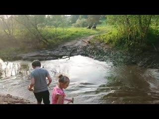 На деревенской речке в День Святого Духа....