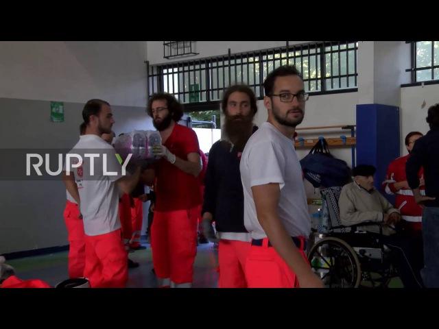 Италия Исламская Помощь доставляет помощь Аматриче жителей
