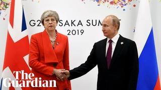 Theresa May exchanges cold handshake with Vladimir Putin