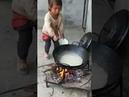 Poor little asian Girl feeding her but Sad
