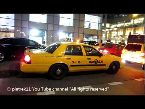 NYPD responding taxi yellow cab undercover New York police car night lights ©