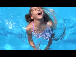 Stock-footage-little-girl-swimming-in-the-pool