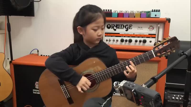 Fly me to the moon By A girl six years old Bossanova guitar playing
