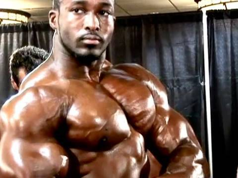 22-year-old bodybuilder Yumon Eaton flexes backstage
